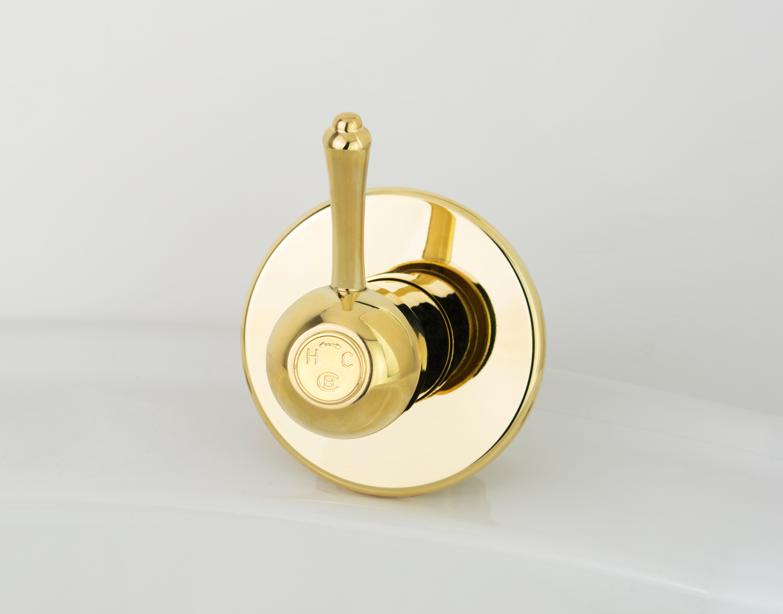 Roulette Lever Wall Mixer in Antique Brass with Engraved Button Upgrade