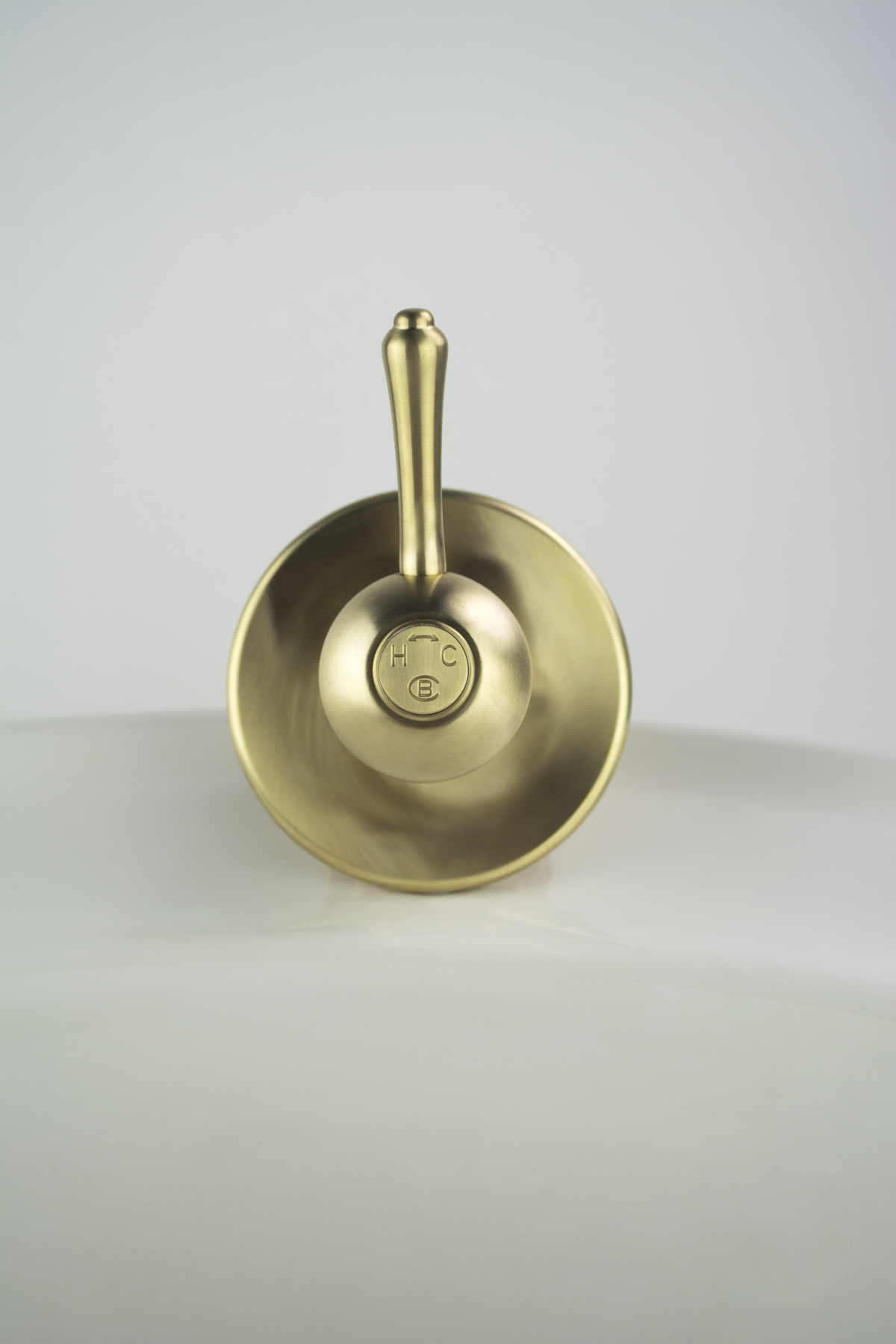 Roulette Lever Wall Mixer in Lea Wheeled Brass finish with Engraved Brass Button Upgrade