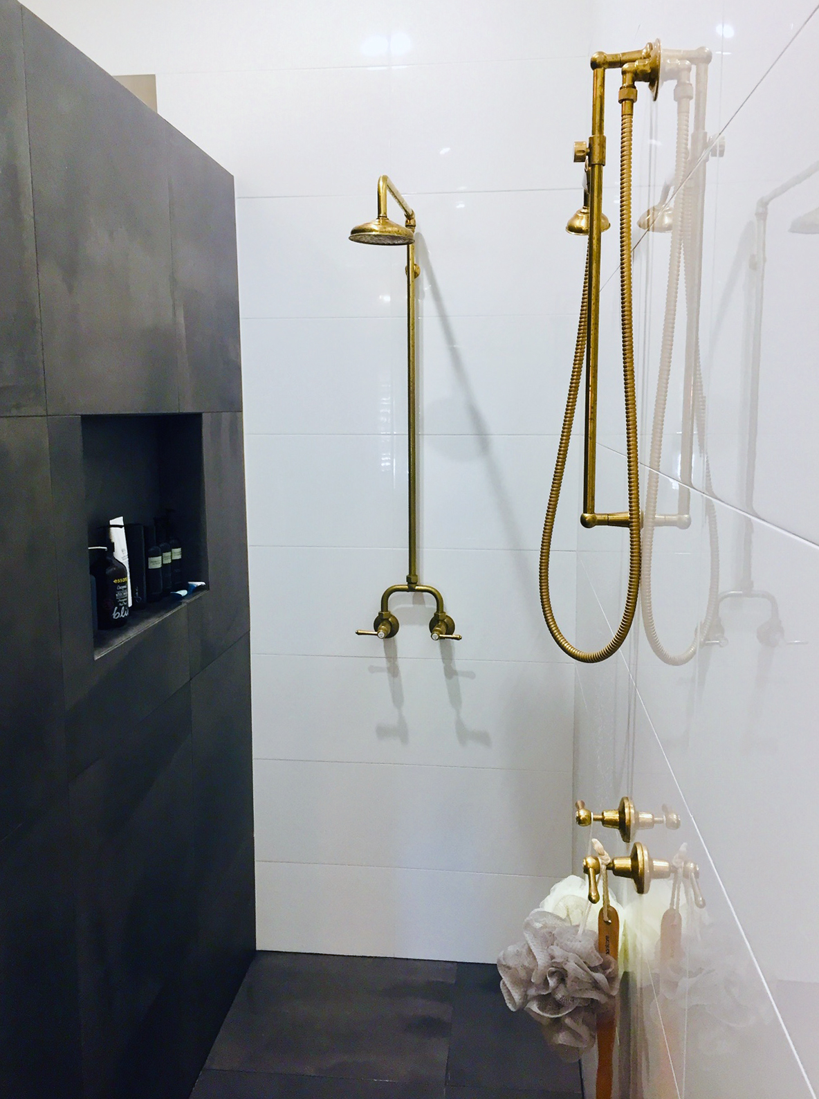 Roulette Lever Alcove Shower Set & Roulette Lever Sliding Rail Shower Kit in Polish to Plate finish. Shown after install with initial maturing.