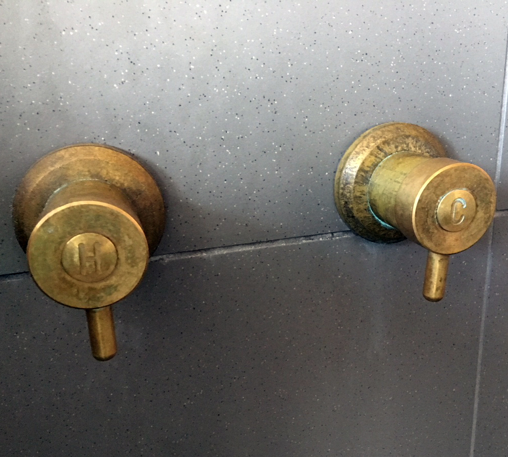 Torrens Lever Wall Top Assembly in Raw Brass Finish with Engraved Button Upgrade